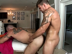 Tattooed gay gets his cock sucked and his pest drilled by his masseur