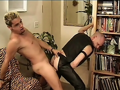Leather-loving baldhead Babaji impales his ass on Mean Dean's member