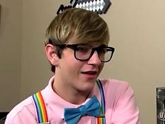 Adorable twink nerd kisses his boyfriend