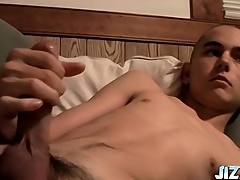 Shaved head skinny boy strokes his chunky cock