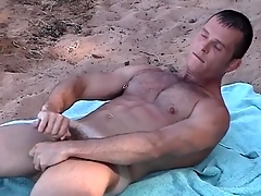 Pierced nipple joyous guy jerks off on a difficulty shore